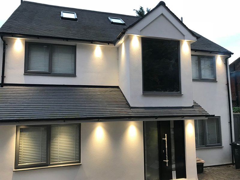 Exterior of a detached house illuminated with downlights installed in the soffits