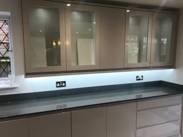 Kitchen wall cupboards with LED lighting beneath