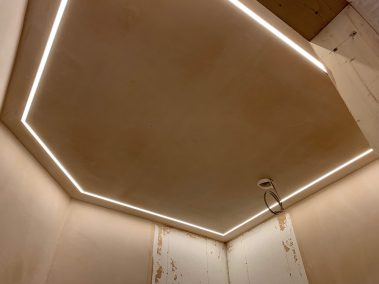 bespoke LED lighting strip installed in the ceiling of an unusual shaped bathroom